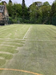 Before and after cleaning sand filled tennis court
